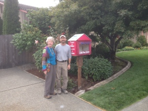 Joanne Stumpf and Rogue Gateway Rotarian Doug Walker stand next to a Free Little Library, which was placed in front of Stumpf's house in northwest Grants Pass. It's one of 10 located in the Grants Pass are.